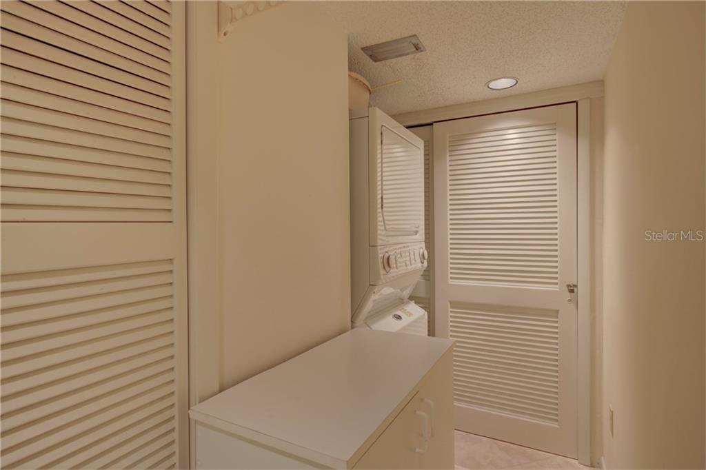 Utility/laundry room - Condo for sale at 5880 Midnight Pass Rd #610, Sarasota, FL 34242 - MLS Number is A4204670