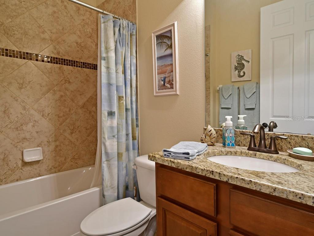 The second guest bath includes a soaking tub - Single Family Home for sale at 6601 Horned Owl Pl, Sarasota, FL 34241 - MLS Number is A4205612