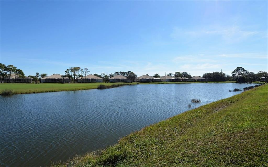 View from lanai. - Villa for sale at 9554 Forest Hills Cir, Sarasota, FL 34238 - MLS Number is A4206506