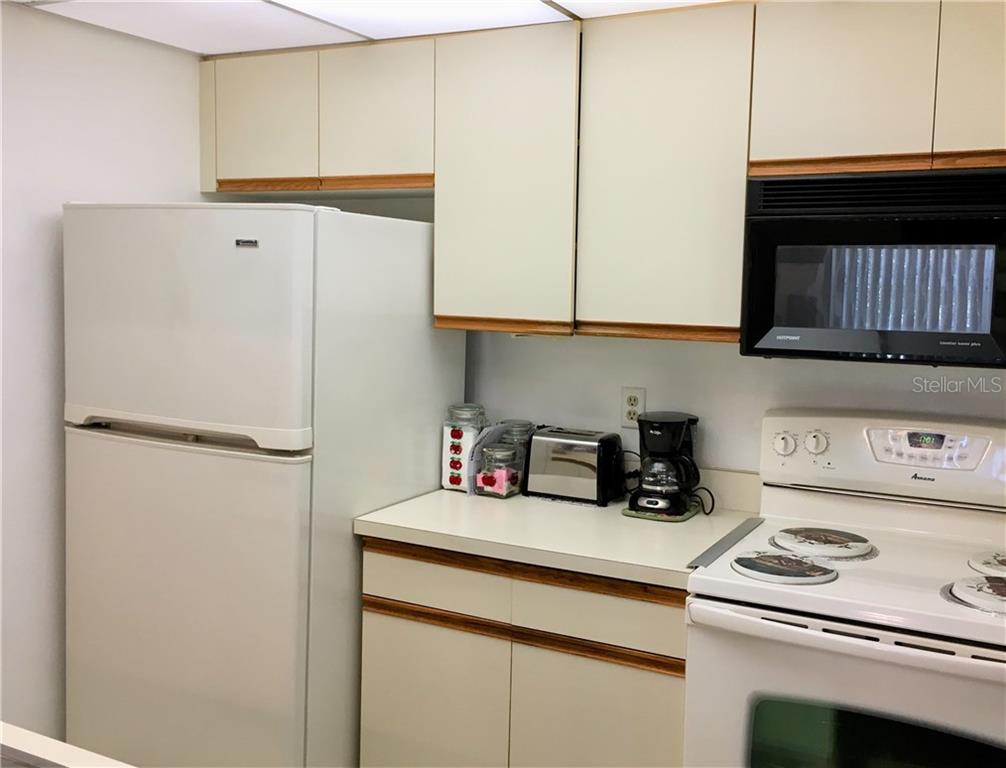Ceramic tiled turnkey furnished kitchen with 2014 dishwasher and garbage disposal. - Condo for sale at 3858 59th Ave W #4178, Bradenton, FL 34210 - MLS Number is A4206819