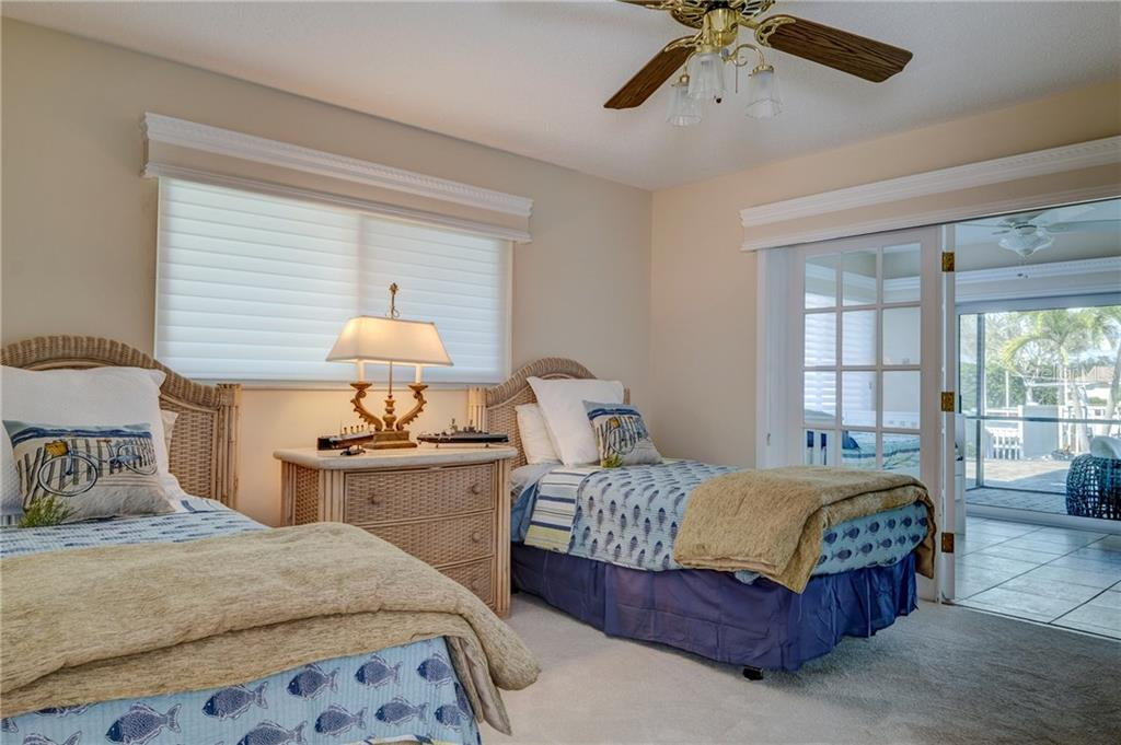 Second bedroom with studio beyond. - Single Family Home for sale at 5633 Cape Leyte Dr, Sarasota, FL 34242 - MLS Number is A4207008