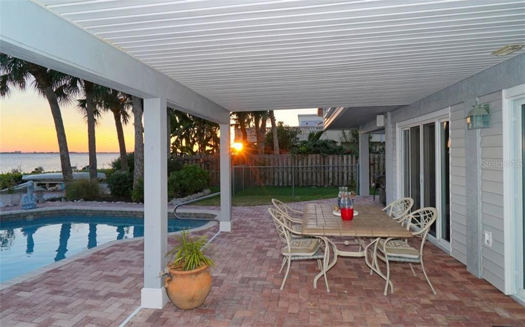 Downstairs patio with covered and open space. - Single Family Home for sale at 3908 Bayside Dr, Bradenton, FL 34210 - MLS Number is A4207355