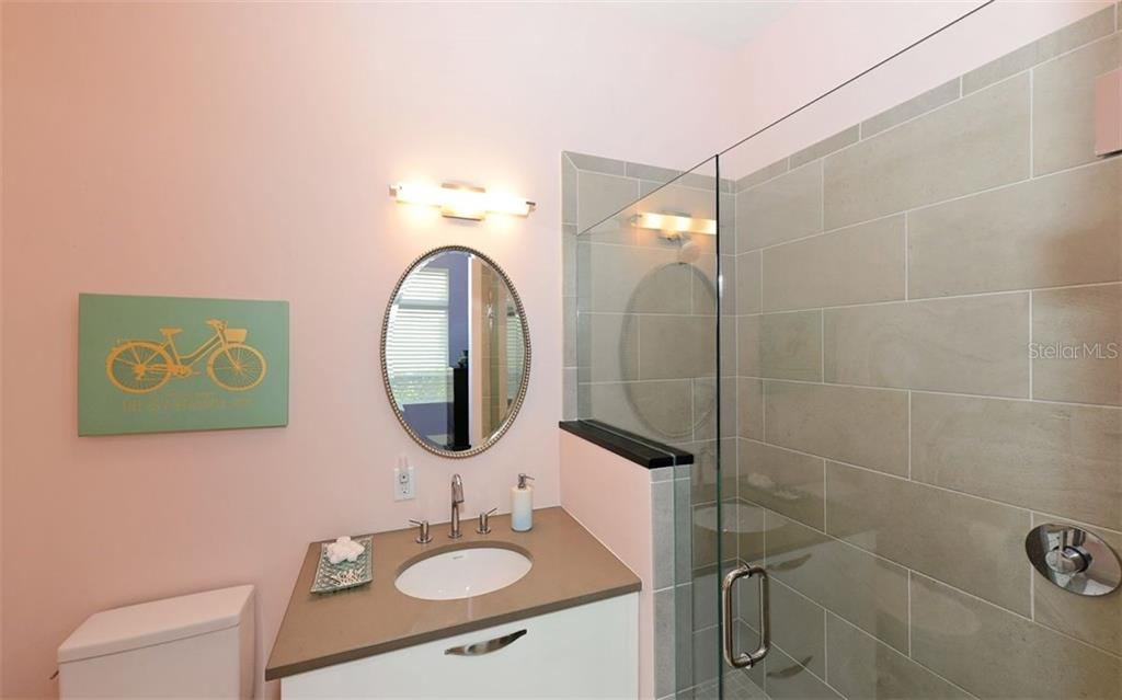 Downstairs guest bath - Townhouse for sale at 234 Cosmopolitan Ct, Sarasota, FL 34236 - MLS Number is A4207722