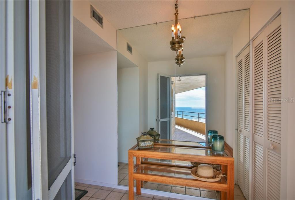 Entry way with reflection of walk way to your unit. - Condo for sale at 5790 Midnight Pass Rd #704, Sarasota, FL 34242 - MLS Number is A4208095