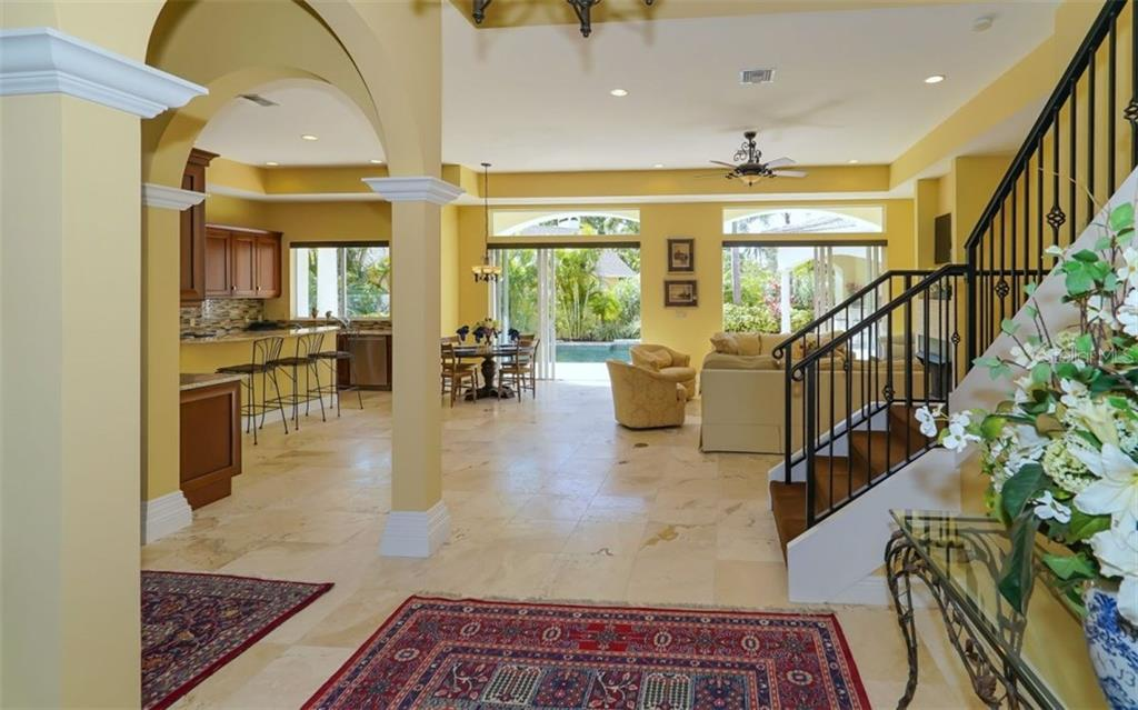 Separate dining area for casual or formal events - Single Family Home for sale at 1179 Morningside Pl, Sarasota, FL 34236 - MLS Number is A4209174
