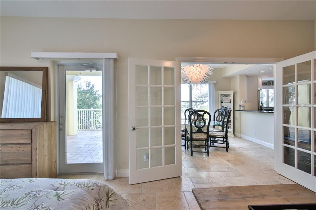 Third Bedroom/Den-French Doors open up to dinette, glass door to balcony. - Condo for sale at 1310 Old Stickney Point Rd #e21, Sarasota, FL 34242 - MLS Number is A4209502