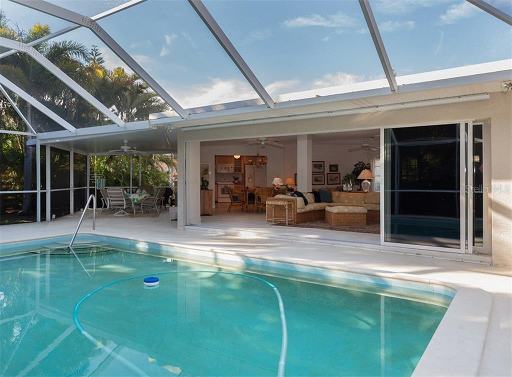 Sliders open to interior - Single Family Home for sale at 445 Mahon Dr, Venice, FL 34285 - MLS Number is A4209507