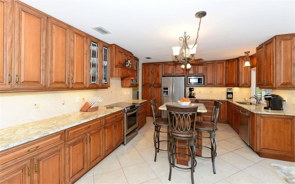 Stunning kitchen with stainless appliances, wood cabinets, granite and tons of storage. - Single Family Home for sale at 5122 Willow Leaf Dr, Sarasota, FL 34241 - MLS Number is A4209555