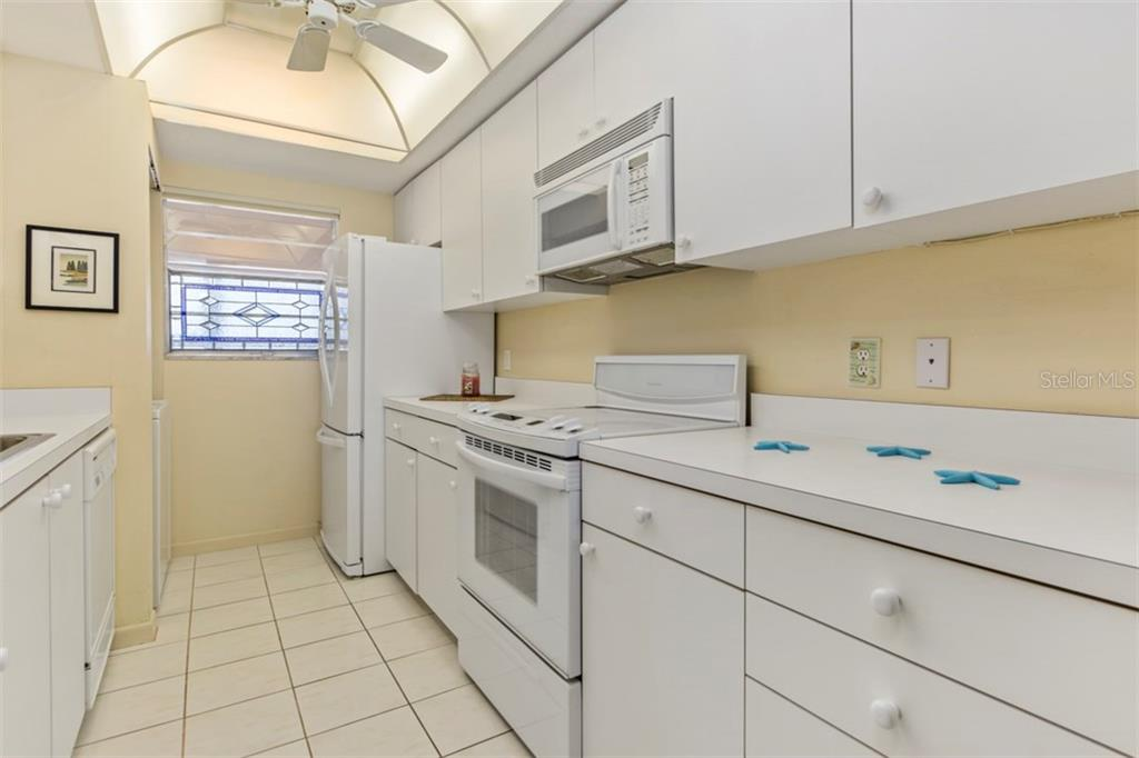 Nice and clean white kitchen - Condo for sale at 6140 Midnight Pass Rd #608, Sarasota, FL 34242 - MLS Number is A4209897