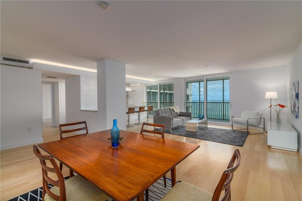 Dining / Living area with sliders to screened terrace - Condo for sale at 4822 Ocean Blvd #11d, Sarasota, FL 34242 - MLS Number is A4209955