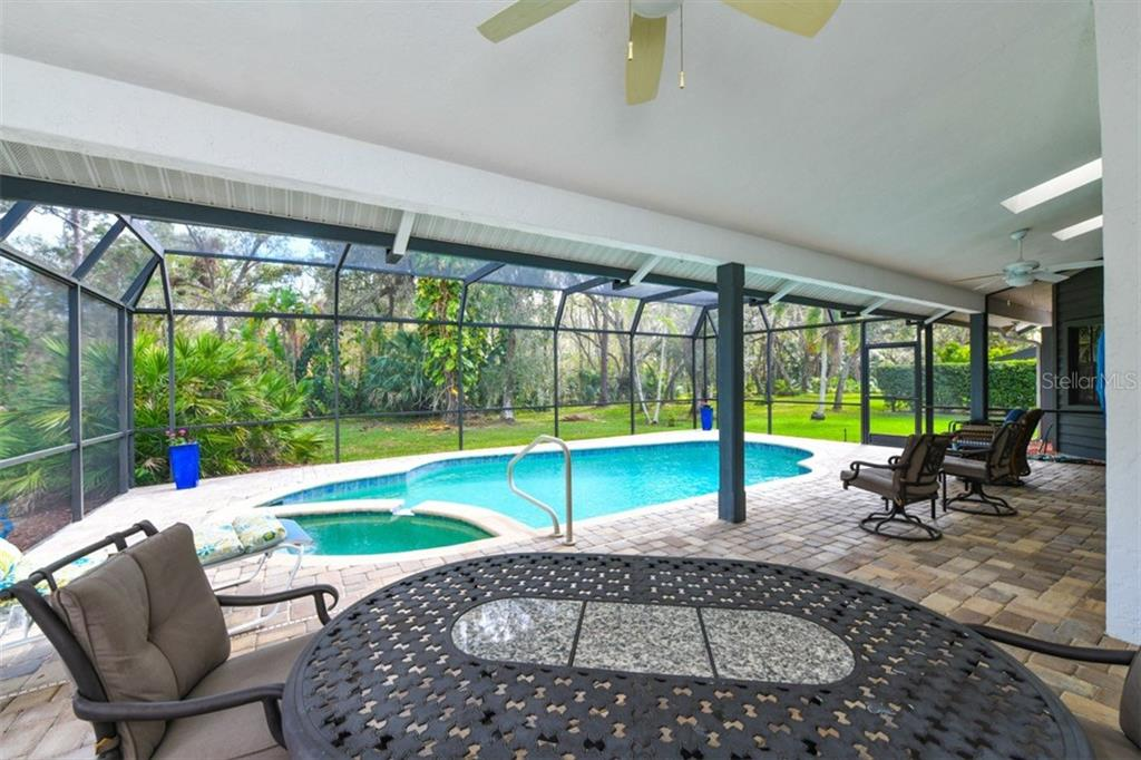 Lanai and pool as seen from the other side. - Single Family Home for sale at 7536 Weeping Willow Dr, Sarasota, FL 34241 - MLS Number is A4210209