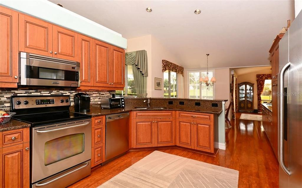 Kitchen - Single Family Home for sale at 571 Khyber Ln, Venice, FL 34293 - MLS Number is A4210343