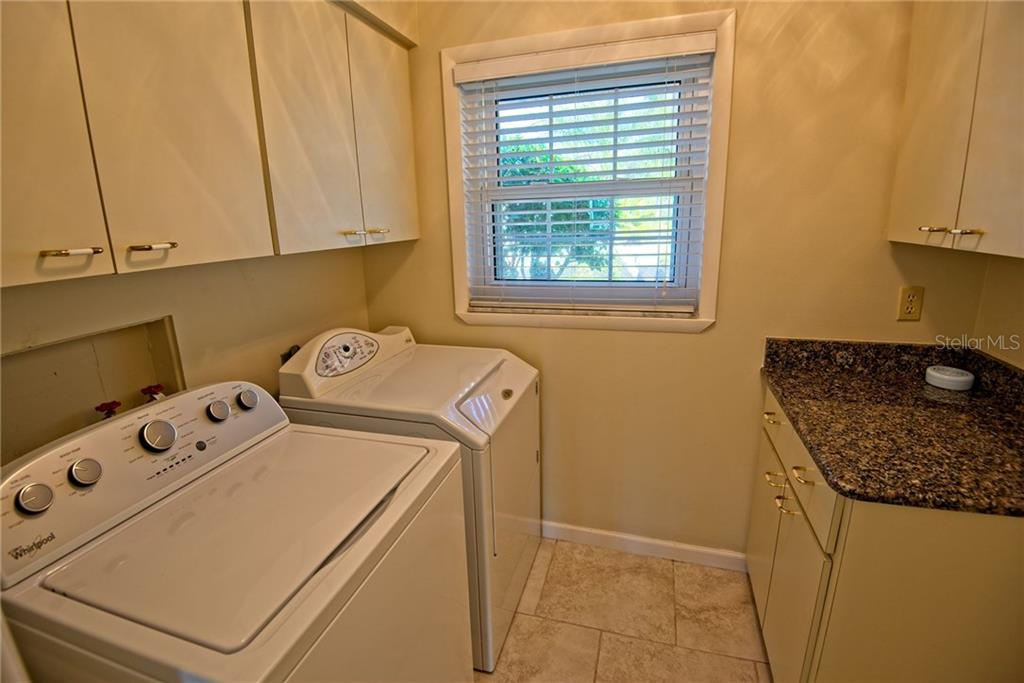 Utility room with washer/dryer included - Single Family Home for sale at 600 Wild Turkey Ln, Sarasota, FL 34236 - MLS Number is A4210585