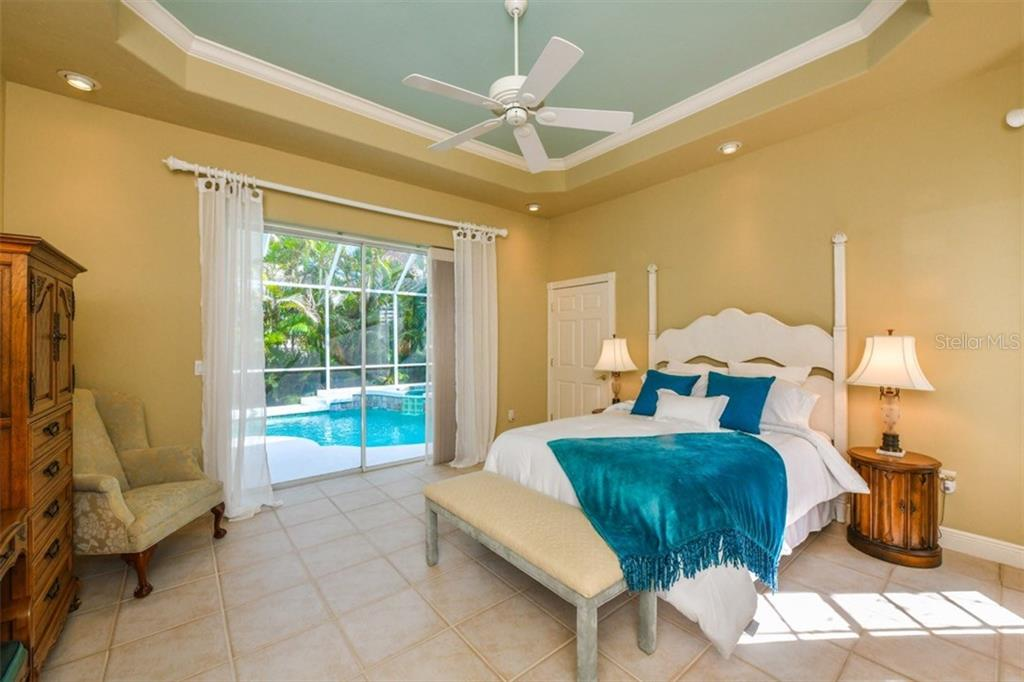 Take a dip in the pool and pamper yourself in your own private sanctuary. Master Bedroom features its own set of sliders leading out to the pool. 2 walk-in closets. - Single Family Home for sale at 5585 Siesta Estates Ct, Sarasota, FL 34242 - MLS Number is A4211109