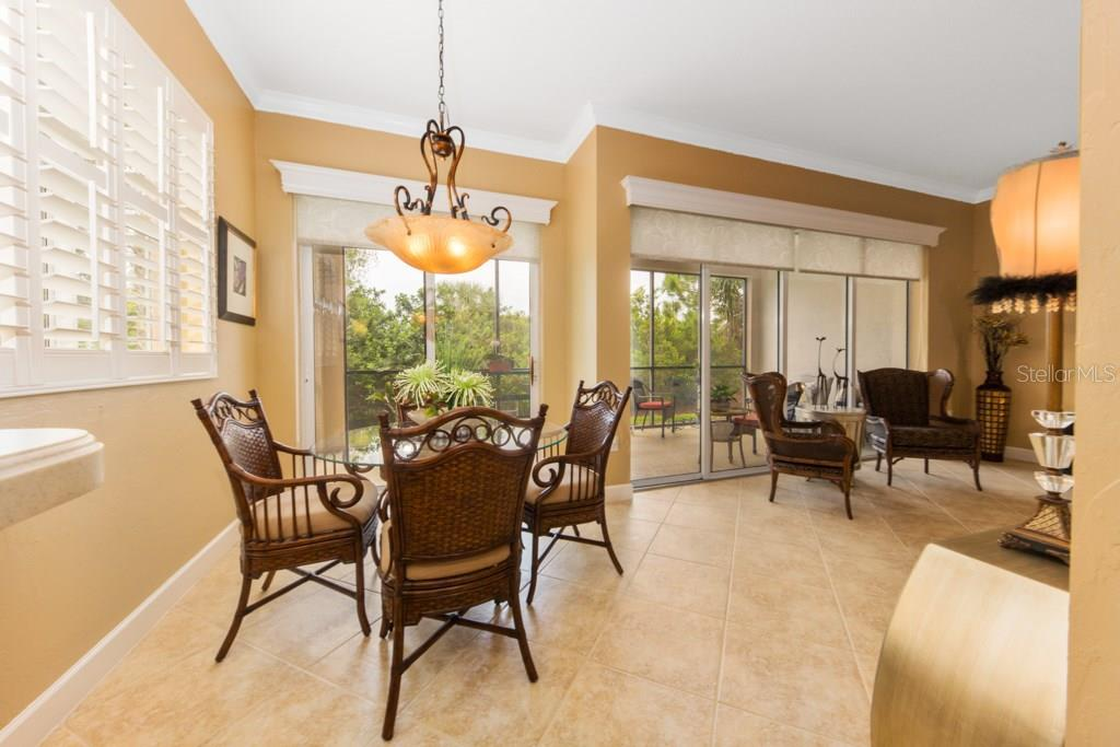 The Morning Room just off the kitchen is enhanced by 8' wide insulated double pane windows and 8' high insulated double pane sliding glass doors. - Condo for sale at 7504 Botanica Pkwy #101, Sarasota, FL 34238 - MLS Number is A4213208