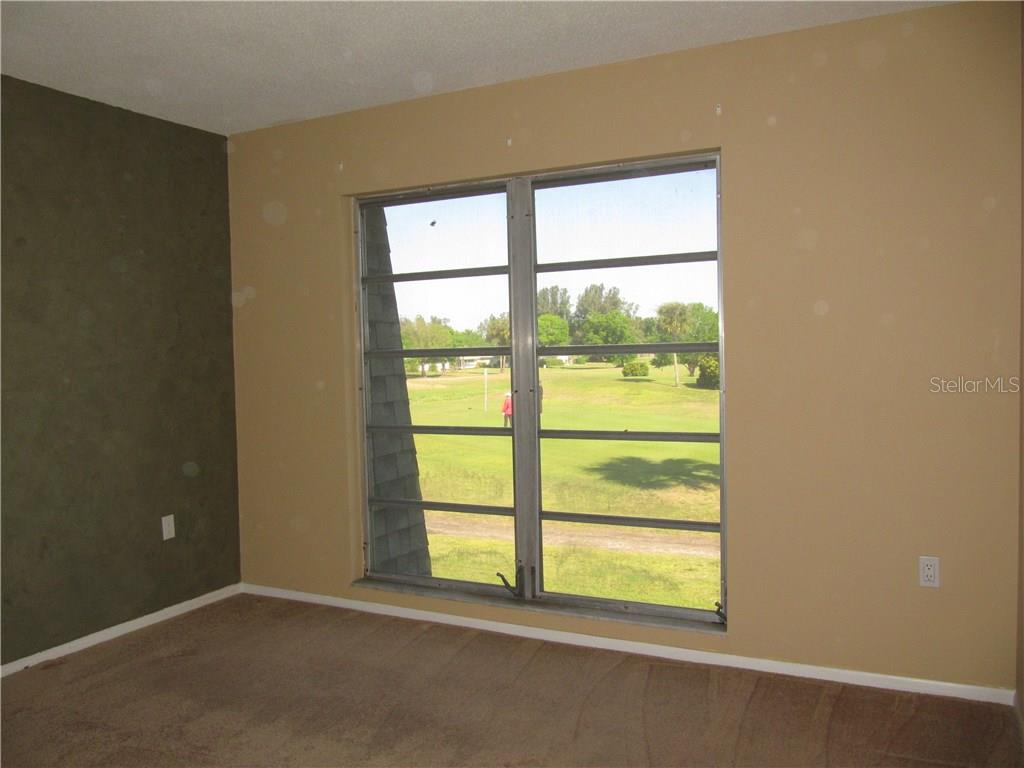 Master Bedroom with Golf Course View - Condo for sale at 3465 Bee Ridge Rd #323, Sarasota, FL 34239 - MLS Number is A4213622