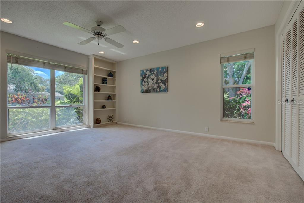 The guest bedrooms are separate from the master suite. - Single Family Home for sale at 3896 Boca Pointe Dr, Sarasota, FL 34238 - MLS Number is A4213831