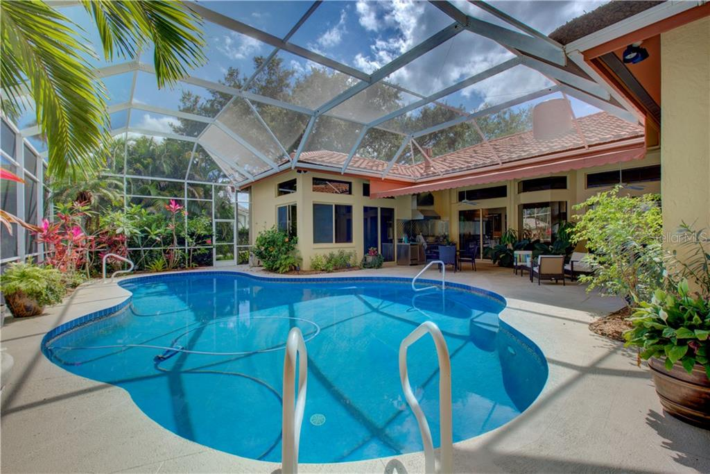 Just the right amount of sun and shade in this tranquil setting overlooking the lake - Single Family Home for sale at 3896 Boca Pointe Dr, Sarasota, FL 34238 - MLS Number is A4213831