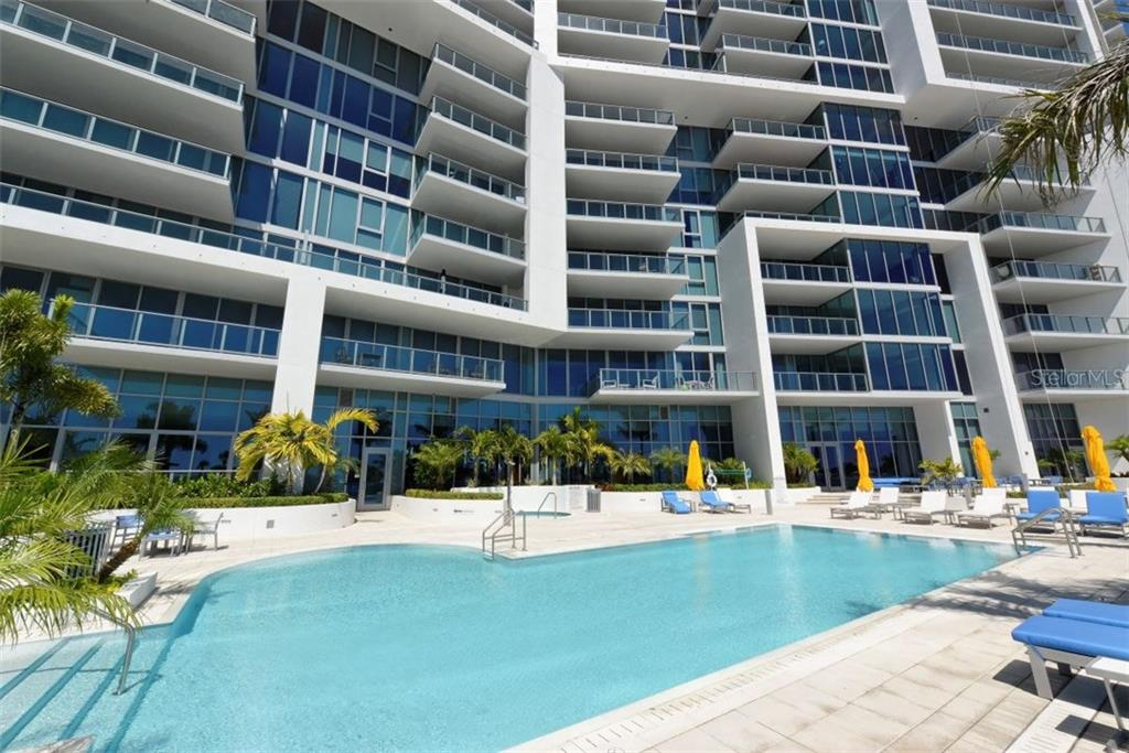 Pool area - the spa is visible in this photo - Condo for sale at 1155 N Gulfstream Ave #1504, Sarasota, FL 34236 - MLS Number is A4215032