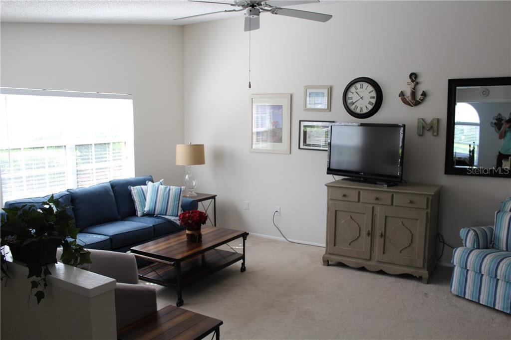 Spacious living room just off the front entrance. - Villa for sale at 5438 Kelly Dr #12, Sarasota, FL 34233 - MLS Number is A4400319