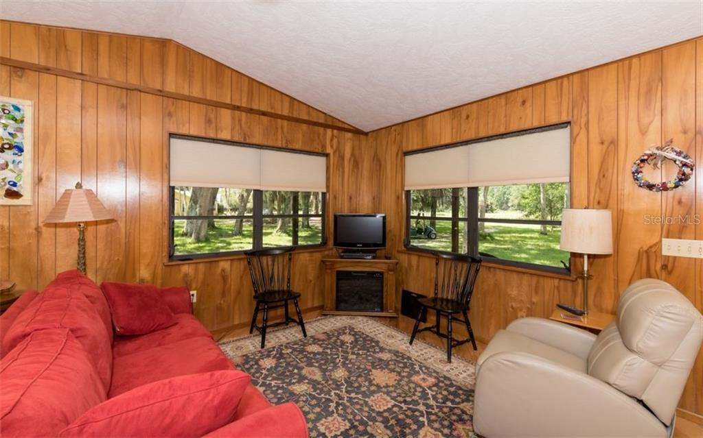 Guest House Living Room - Single Family Home for sale at 7865 27th St E, Sarasota, FL 34243 - MLS Number is A4400492