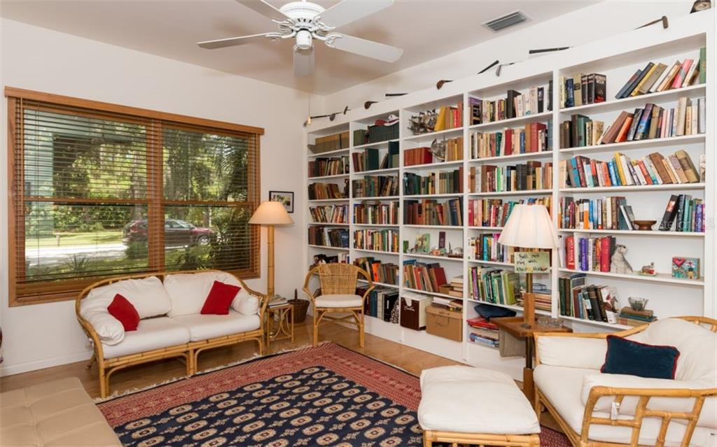 Main House Office, Den, Library - Single Family Home for sale at 7865 27th St E, Sarasota, FL 34243 - MLS Number is A4400492