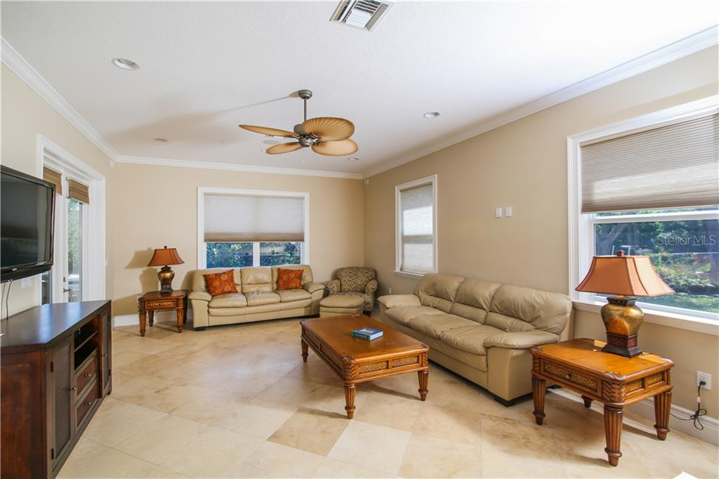 First Floor Family Room with wet bar and wine refrigerator - Single Family Home for sale at 432 Sorrento Dr, Osprey, FL 34229 - MLS Number is A4402898