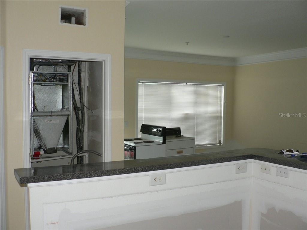 Air Handler in Closet and Living Room in Background - Condo for sale at 4802 51st St W #906, Bradenton, FL 34210 - MLS Number is A4403780