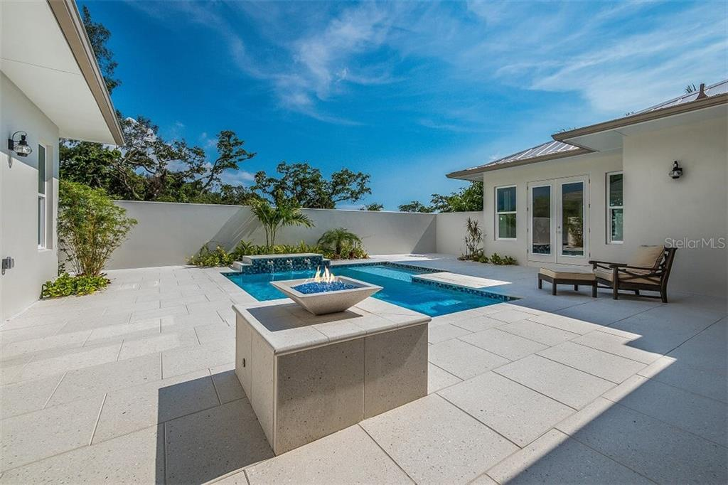 Single Family Home for sale at 660 Neptune Ave, Longboat Key, FL 34228 - MLS Number is A4404618