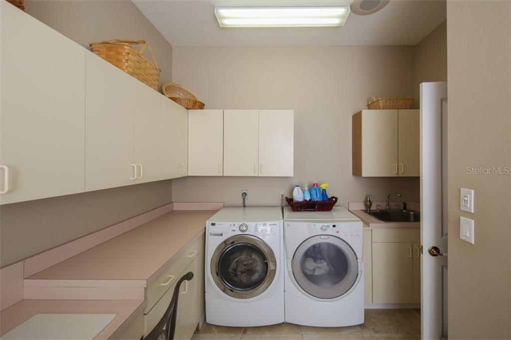 Large Laundry Room - Single Family Home for sale at 1778 Bayshore Dr, Englewood, FL 34223 - MLS Number is A4405962