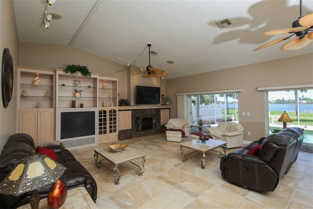 Downstairs extra large living room - Single Family Home for sale at 1778 Bayshore Dr, Englewood, FL 34223 - MLS Number is A4405962