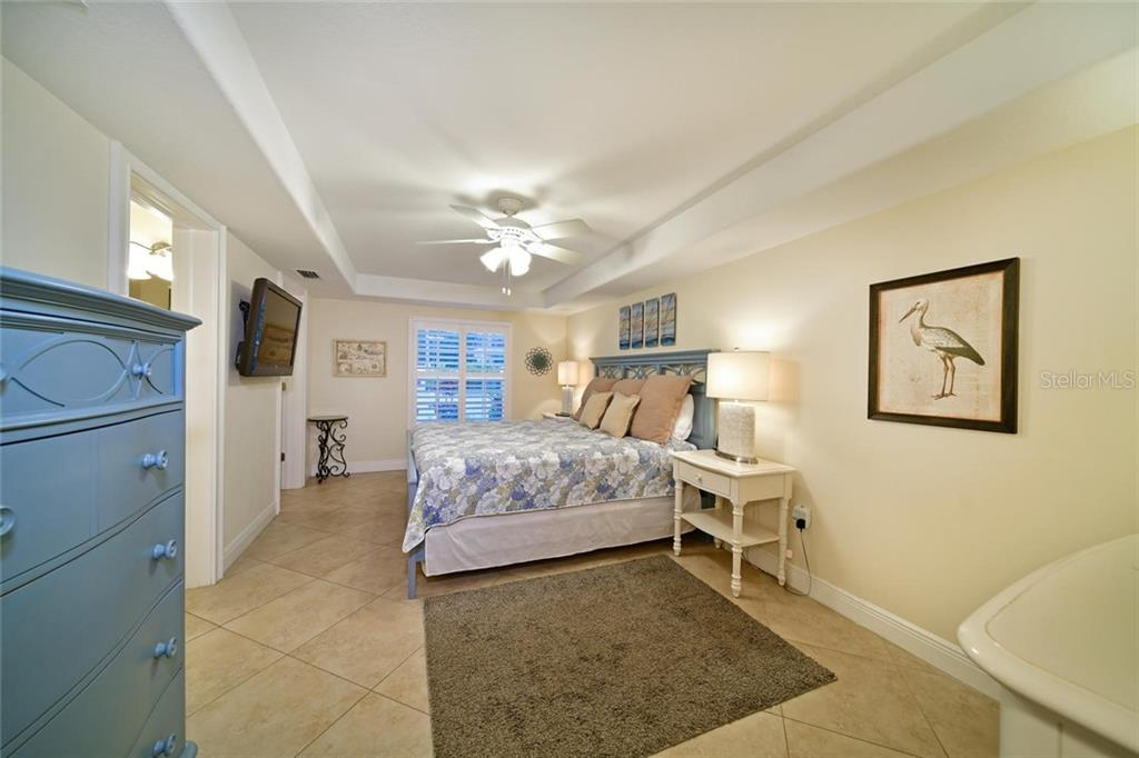 The large master bedroom has its own bathroom and walk in closet. - Single Family Home for sale at 113 36th St, Holmes Beach, FL 34217 - MLS Number is A4407267