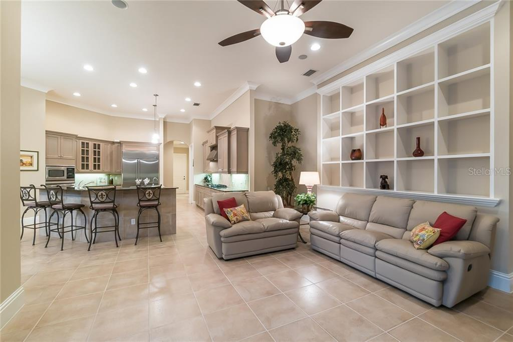The family room is open to the kitchen and dinette. - Single Family Home for sale at 13223 Palmers Creek Ter, Lakewood Ranch, FL 34202 - MLS Number is A4408290