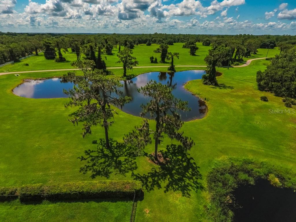 SRC - Looking across at Lot 4 with Lot 5 (back to the right) - Vacant Land for sale at Address Withheld, Sarasota, FL 34240 - MLS Number is A4408726
