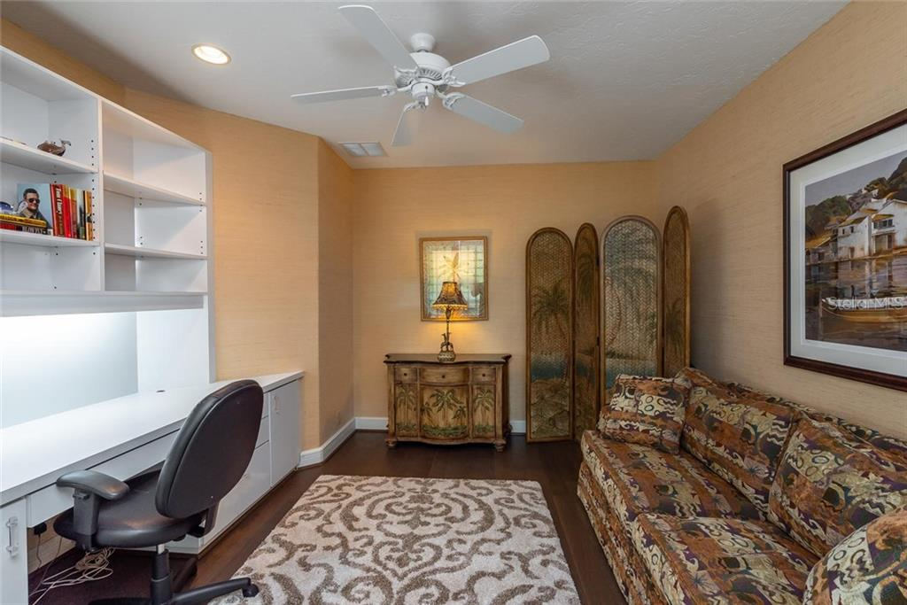 Office/Den located off the foyer with a beautiful white built-in desk and engineered hardwood floors. - Condo for sale at 340 Gulf Of Mexico Dr #116, Longboat Key, FL 34228 - MLS Number is A4411000