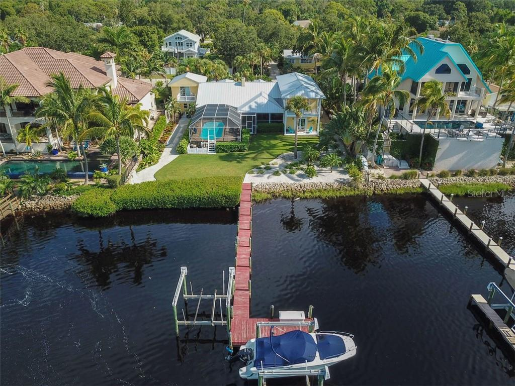 Picture perfect, tropical landscaping. Incredible Bayfront waterfront lifestyle. - Single Family Home for sale at 417 Bayview Pkwy, Nokomis, FL 34275 - MLS Number is A4411087