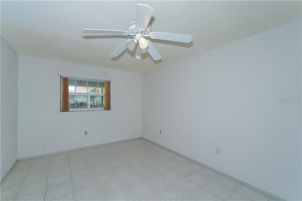 Bedroom first level - Single Family Home for sale at 5591 Cape Aqua Dr, Sarasota, FL 34242 - MLS Number is A4411099