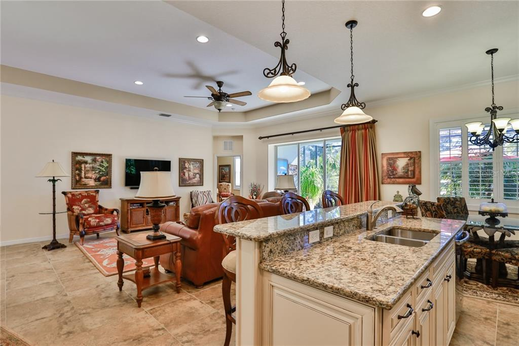 Level 5 kitchen cabinets, granite counters, and upgraded stainless steel appliances. Large freezer at the bottom. Add'l recessed lighting and upgraded light fixtures from Progress Lighting. - Single Family Home for sale at 11508 Griffith Park Ter, Bradenton, FL 34211 - MLS Number is A4412167