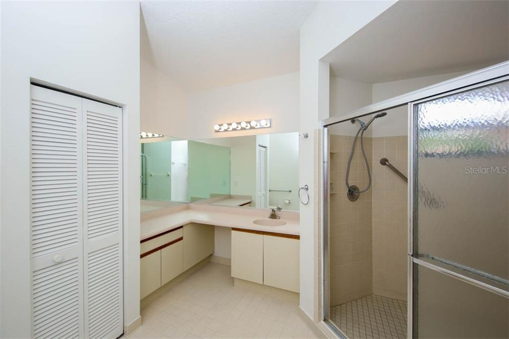 Enormous walk-in shower in the master bath - must see to appreciate the generous size. - Condo for sale at 1716 Starling Dr #204, Sarasota, FL 34231 - MLS Number is A4412237