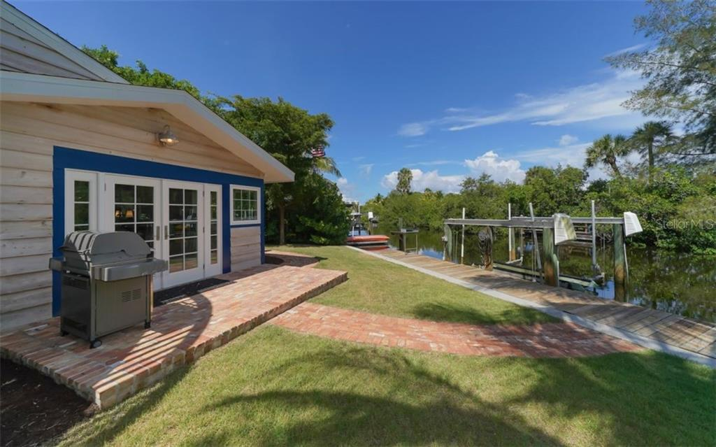 Alternate view of rear....Privacy abounds! - Single Family Home for sale at 138 Island Cir, Sarasota, FL 34242 - MLS Number is A4412265