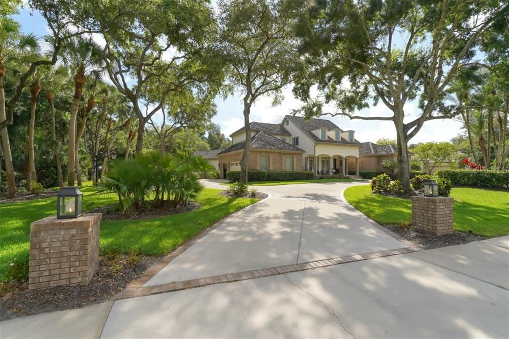 From the double wide sidewalk (8 miles of sidewalks in Laurel Oak!) - Single Family Home for sale at 3183 Dick Wilson Dr, Sarasota, FL 34240 - MLS Number is A4412326