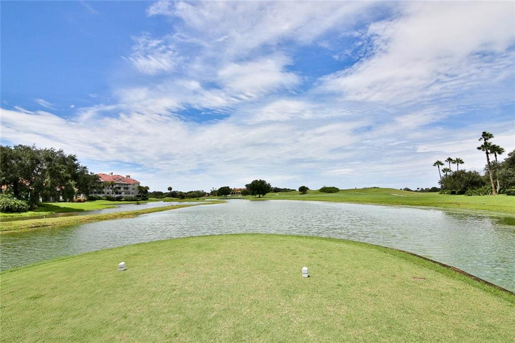 Just a little water to get to the green - Villa for sale at 7686 Calle Facil, Sarasota, FL 34238 - MLS Number is A4413755