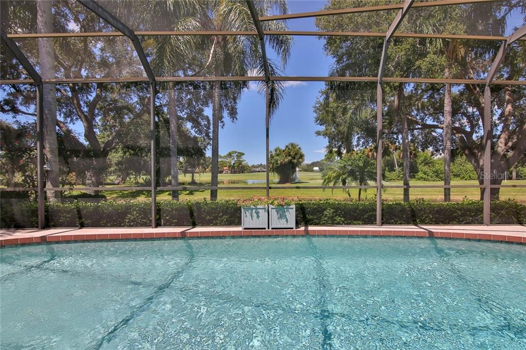 Scenic water and golf course views. - Villa for sale at 7686 Calle Facil, Sarasota, FL 34238 - MLS Number is A4413755