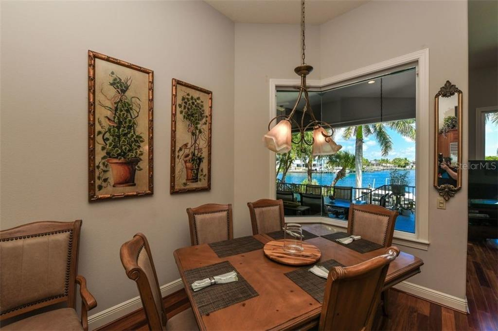 Breakfast room with aquarium glass window. - Single Family Home for sale at 1483 Tangier Way, Sarasota, FL 34239 - MLS Number is A4414757