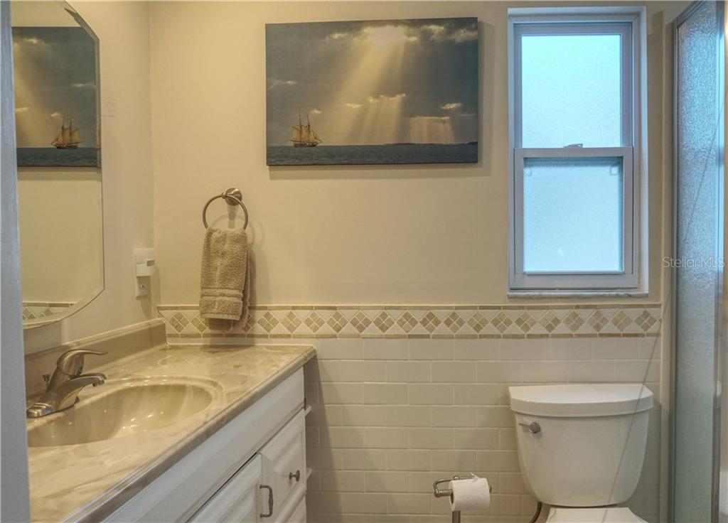 Updated Master bathroom. - Villa for sale at 682 Spanish Dr S, Longboat Key, FL 34228 - MLS Number is A4414905