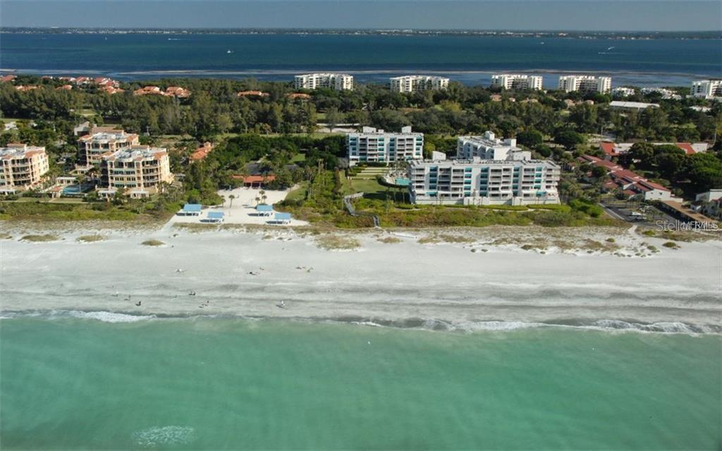 Aerial view of private Bay Isles Beach Club - Single Family Home for sale at 3529 Fair Oaks Ln, Longboat Key, FL 34228 - MLS Number is A4414992