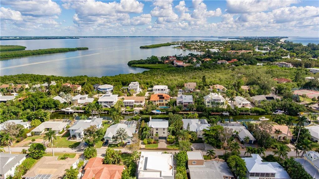 The gorgeous neighborhood of Sleepy Lagoon, where almost everyone has a canal out back, the open bay is moments away with no fixed bridges to the Gulf of Mexico and the deeded Gulf beaches are a short distance away. - Single Family Home for sale at 660 Marbury Ln, Longboat Key, FL 34228 - MLS Number is A4415911