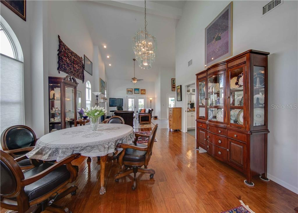 Open, light filled great room with fabulous flooring through out. - Single Family Home for sale at 660 Marbury Ln, Longboat Key, FL 34228 - MLS Number is A4415911