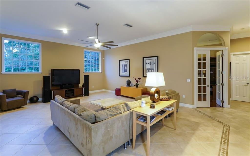 Family Room - Single Family Home for sale at 7698 Albert Tillinghast Dr, Sarasota, FL 34240 - MLS Number is A4416123