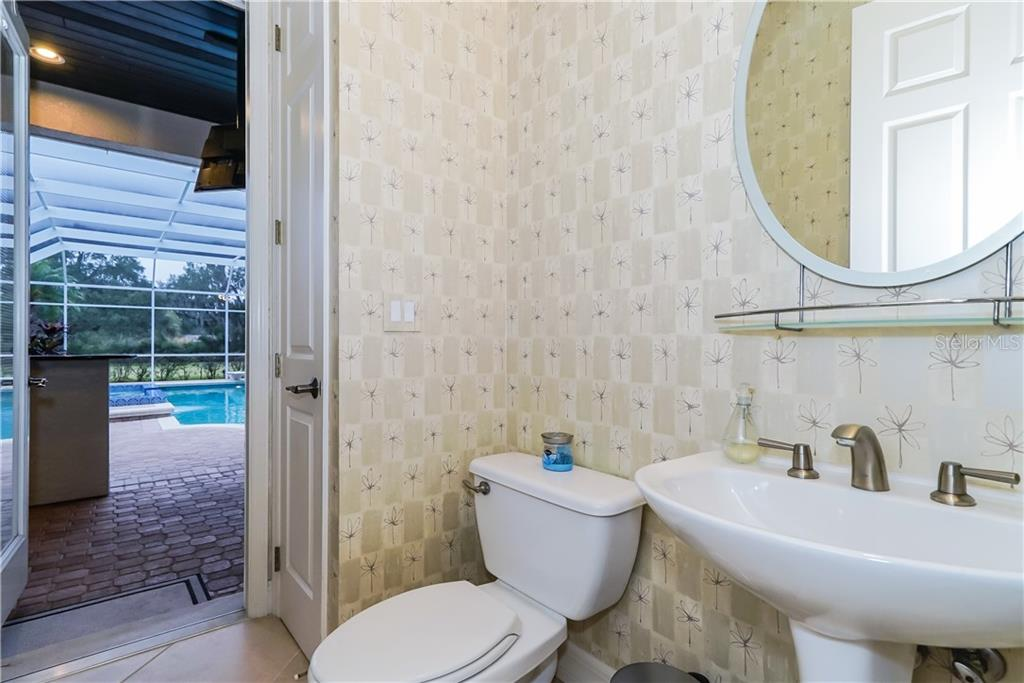 Powder Room/Pool Bath - Single Family Home for sale at 7698 Albert Tillinghast Dr, Sarasota, FL 34240 - MLS Number is A4416123